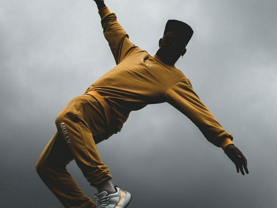 man wearing yellow outfit